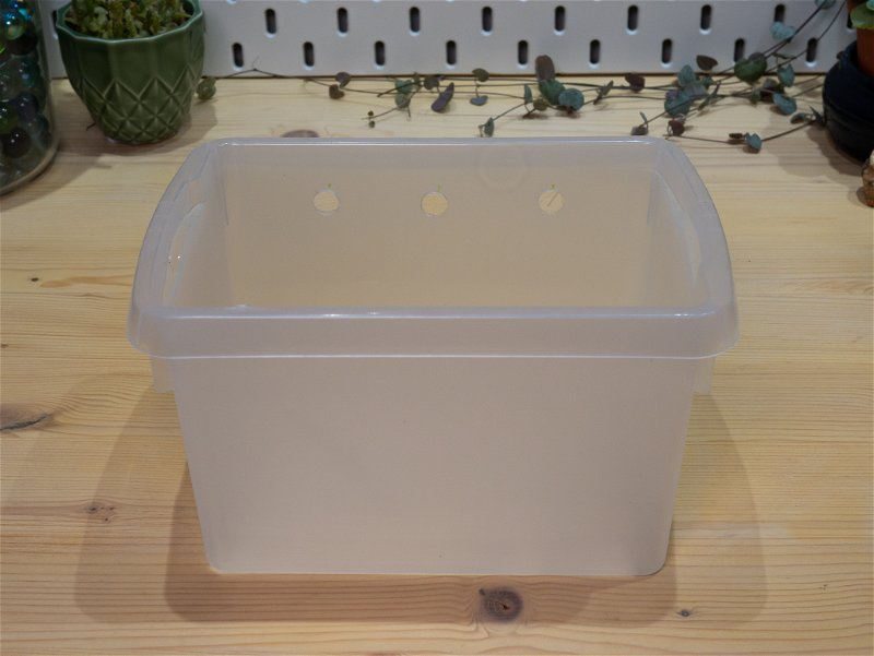 Plastic box with holes drilled for tubes