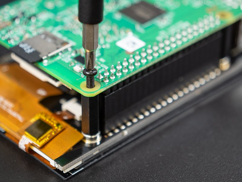 Pi attached to standoffs with screws
